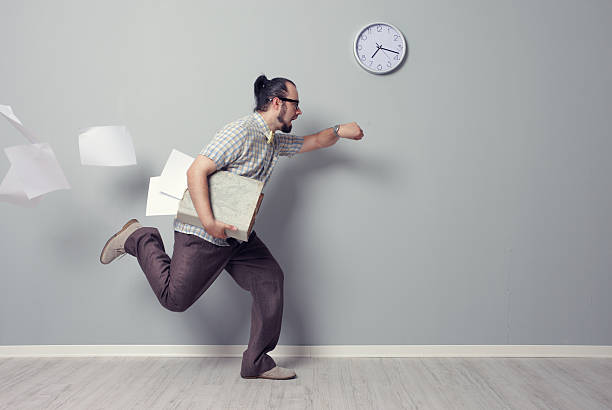 Running Out of Time Stressed business man rushing in the office early 20th century stock pictures, royalty-free photos & images