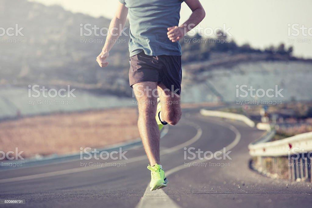 running outdoor on asphalt road stock photo