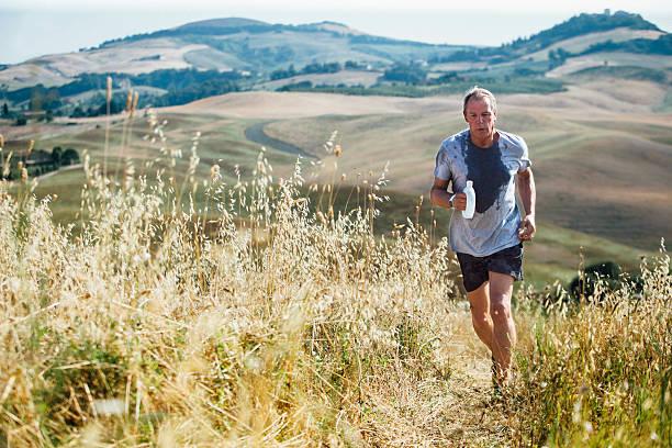 running outdoors - jogging hill bildbanksfoton och bilder