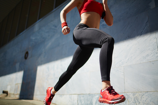 Active girl running in the morning outdoors