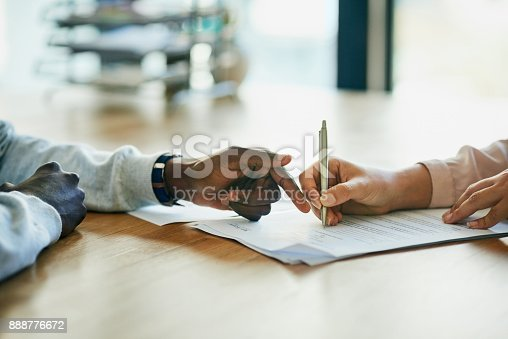 istock Running over the terms and conditions in her contract 888776672