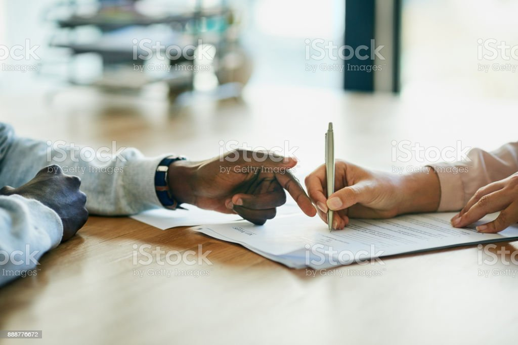 Running over the terms and conditions in her contract stock photo