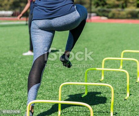 976685710 istock photo Running over yellow mini hurdles 975221476