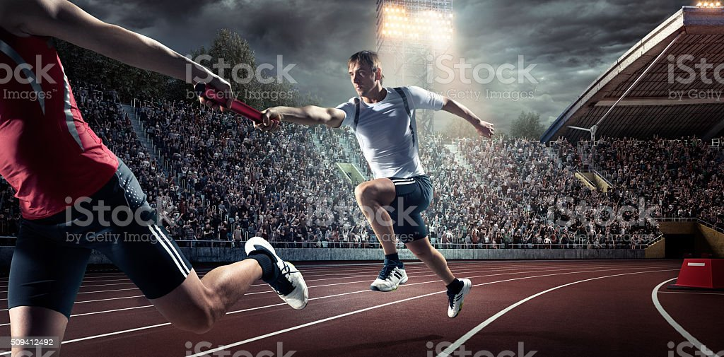 Running Pass on . Stadium stock photo