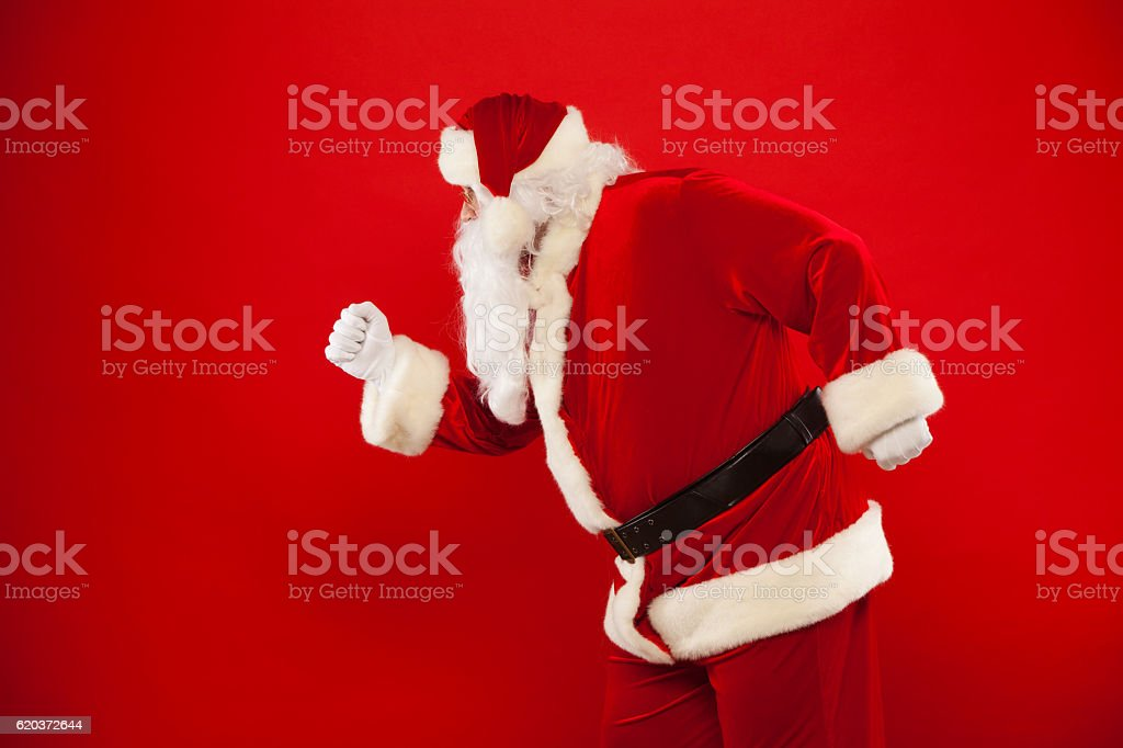 Running Santa Claus red background Merry Christmas. foto de stock royalty-free