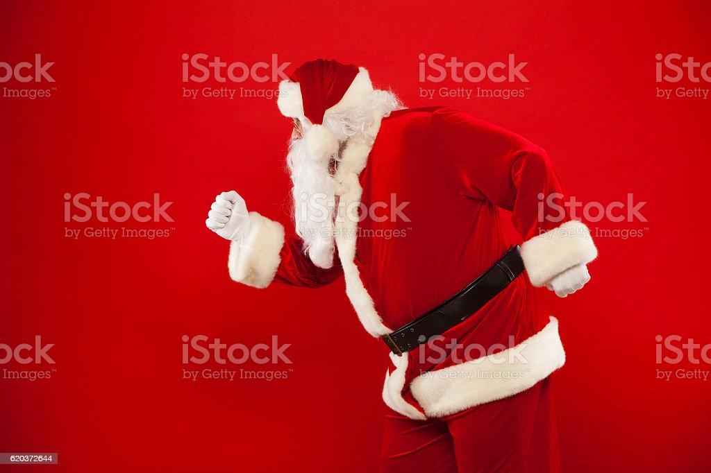 Running Santa Claus red background Merry Christmas. zbiór zdjęć royalty-free