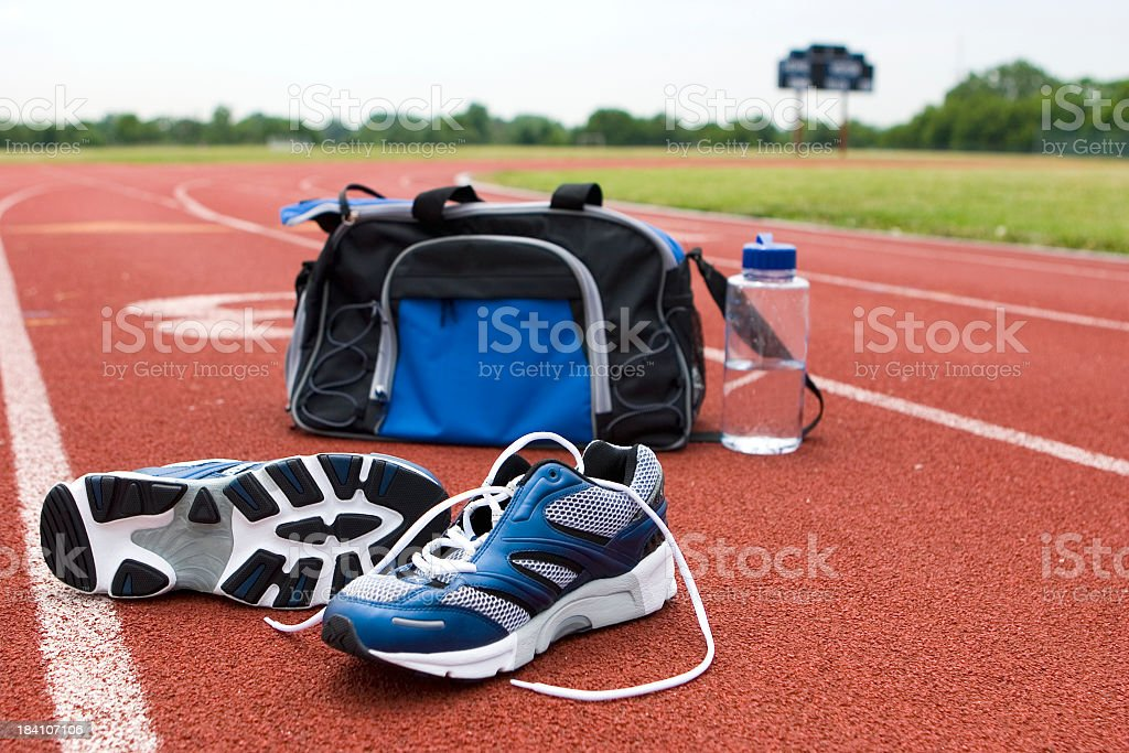 Running Shoes & Bag on Track III royalty-free stock photo