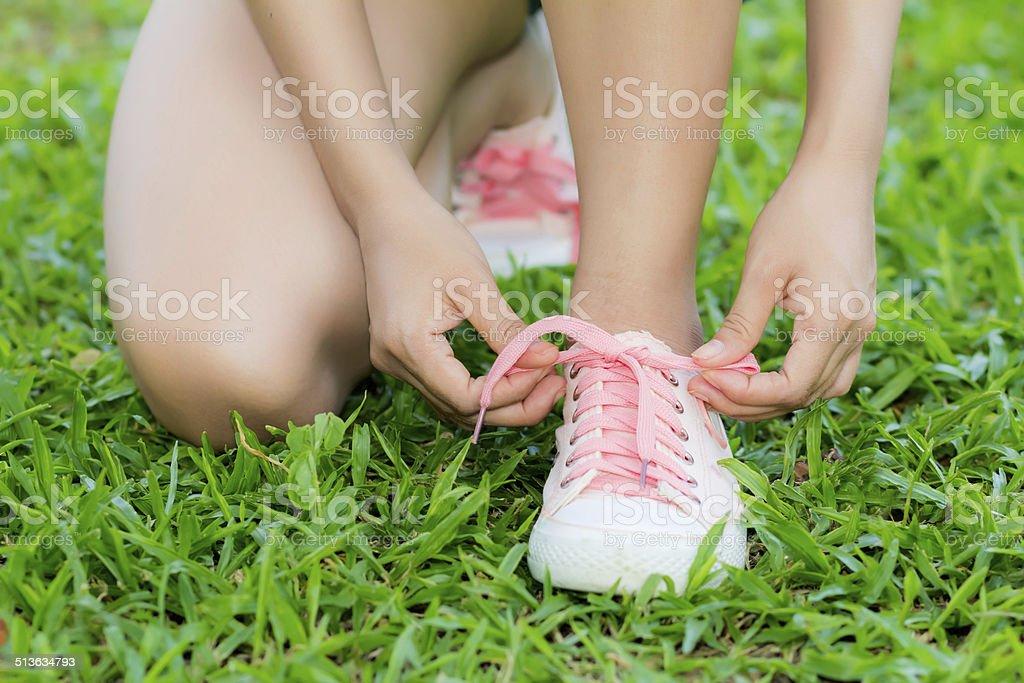 running shoes closeup of woman stock photo