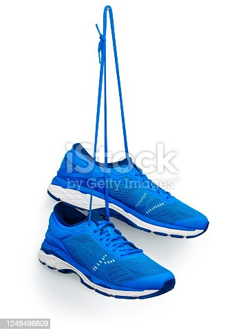 A pair of blue running shoes hanging from a hook.  Isolated on a white background.