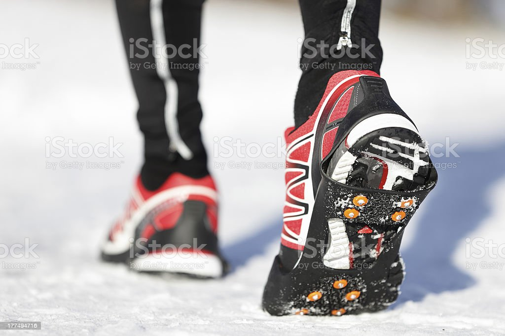 Running shoes in snow stock photo
