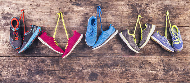 running shoes on the floor - pair stock photos and pictures