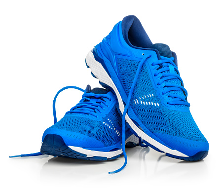 A pair of blue running shoes.  Isolated on a white background.