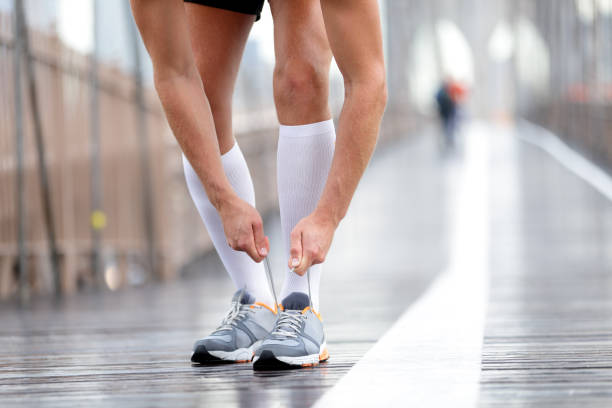 Running shoes - Runner man tying laces, New York stock photo