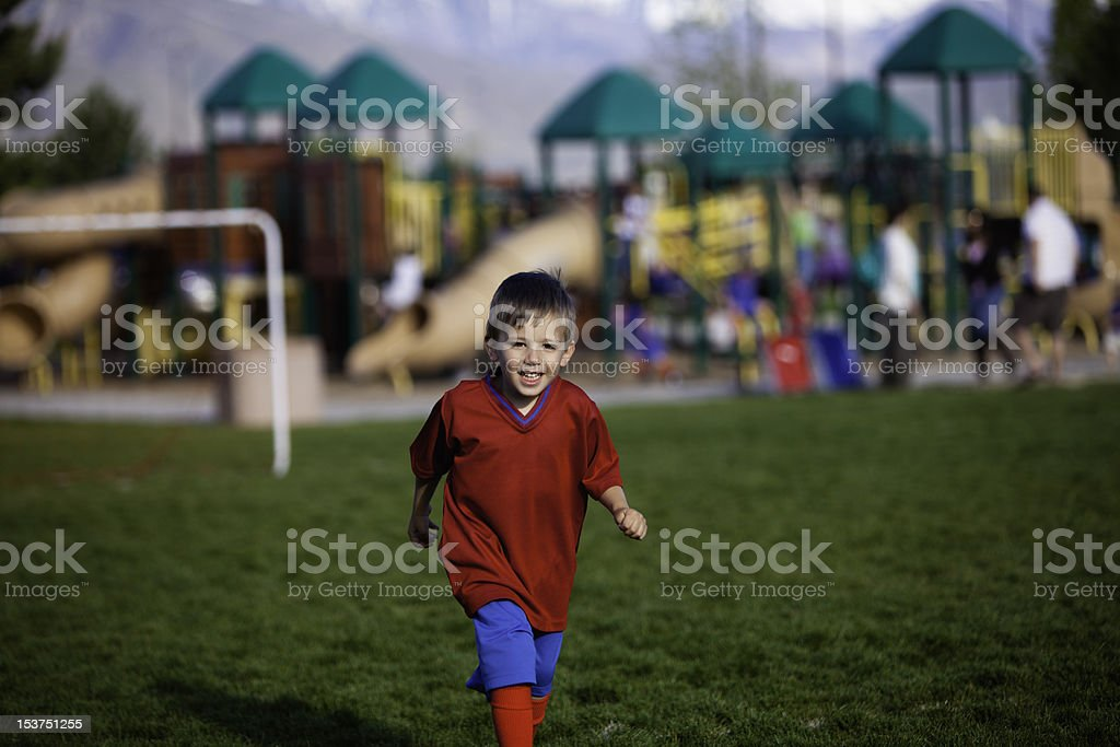 Running Soccer Boy royalty-free stock photo