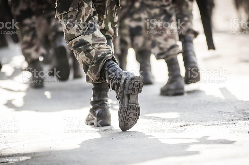 running soldiers carrying weapons stock photo