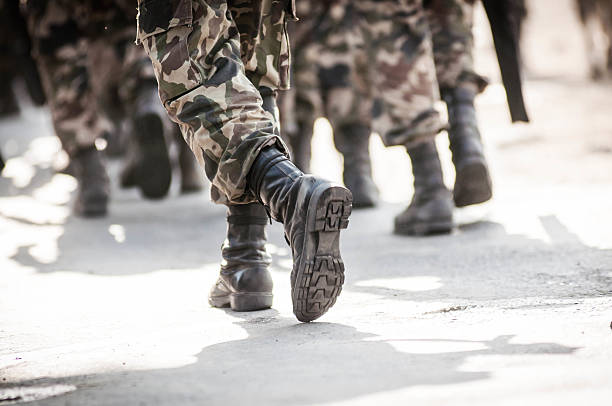 running soldiers carrying weapons - armed forces stock photos and pictures