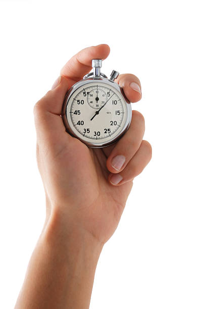 Running stopwatch in the hand Running stopwatch in the hand, vertical composition, isolated on white timer stock pictures, royalty-free photos & images
