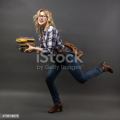 1048561866 istock photo running student girl rush to class with stack of books 475519070