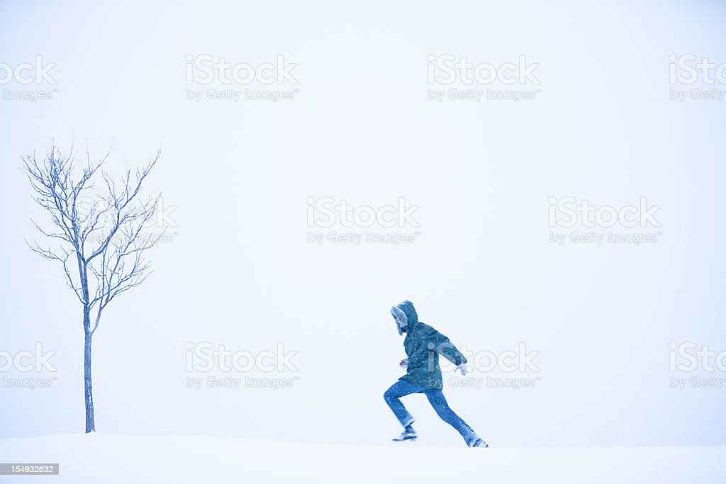 Running through a blizzard royalty-free stock photo
