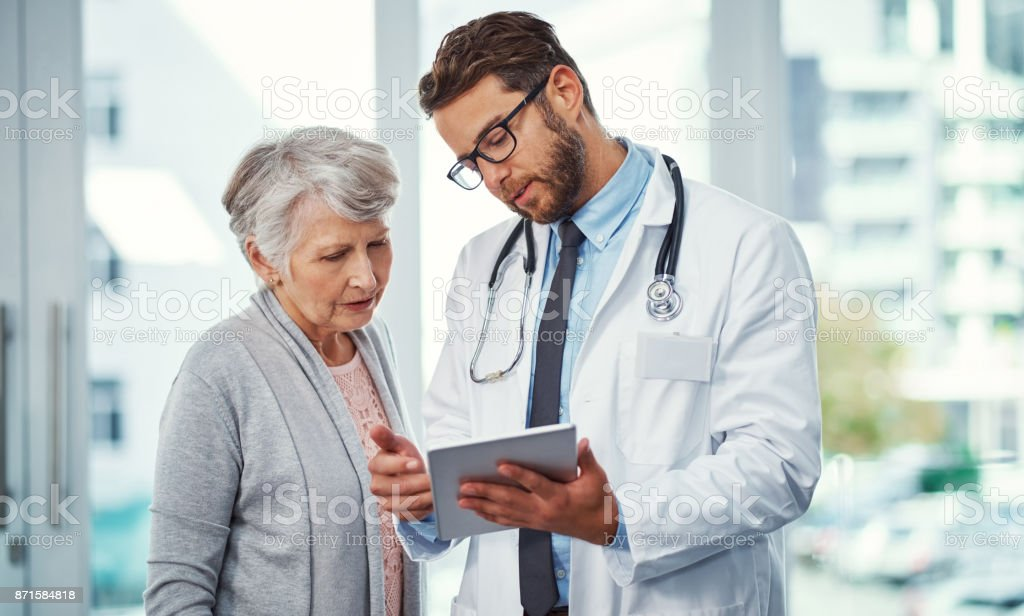 Running through a treatment plan with a patient stock photo
