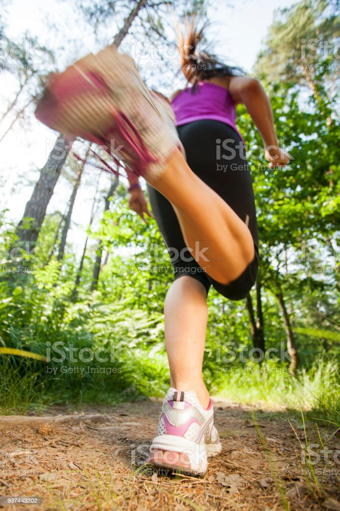 Running through woods - low angle view stock photo
