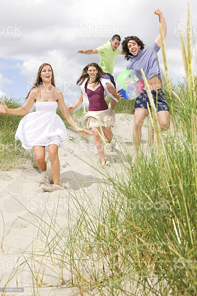Running to the beach royalty-free stock photo