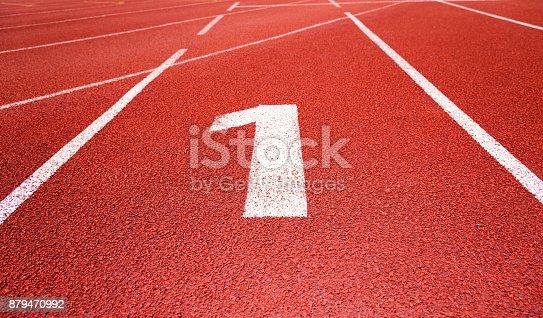 istock Running track number 1 in sport field 879470992