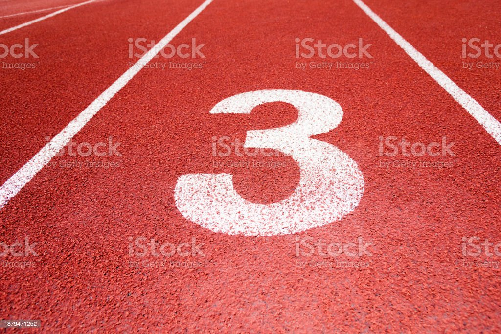 Running track number 3 in sport field stock photo