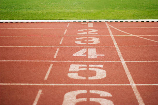 Running track number and green grass outdoor stock photo