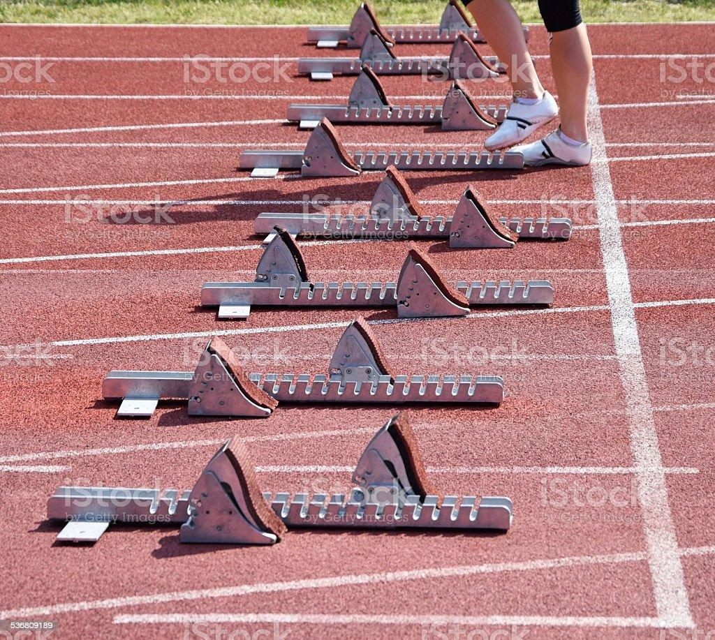 Running track starting machines stock photo