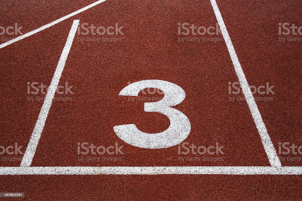 Running track with number 3, texture for background. stock photo