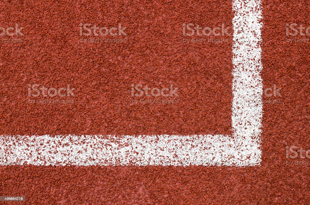 Running track with white striped on redbrick color background. stock photo