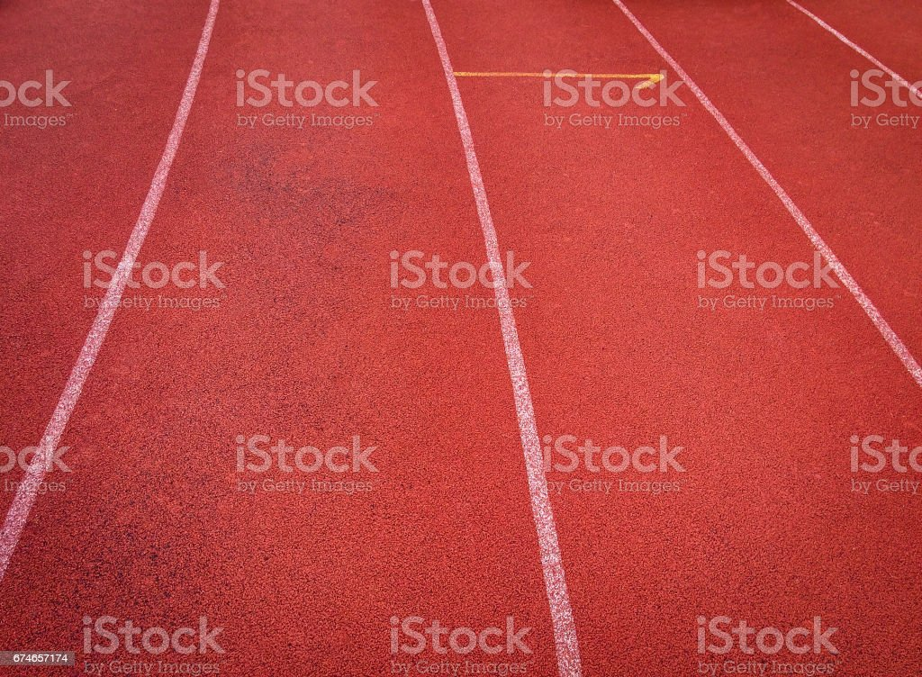 Running tracks with red rubber aggregate mix surface. stock photo