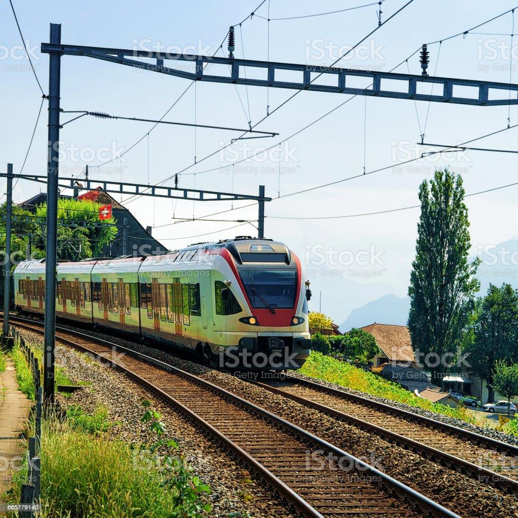 Running train at Vineyard Terraces of Lavaux Switzerland stock photo