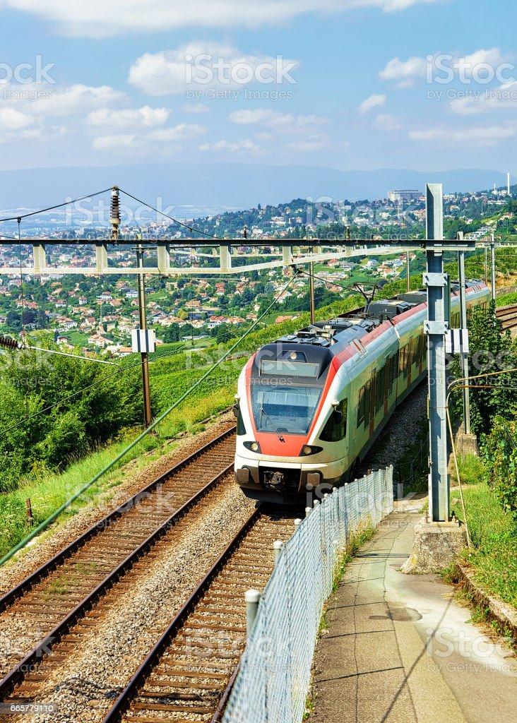 Running train in Vineyard Terraces of Lavaux of Switzerland stock photo