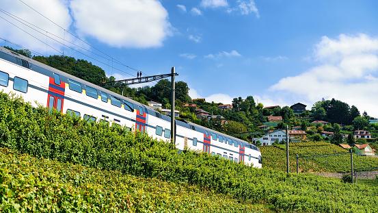 Running train near Lavaux Vineyard Terraces hiking trail of Swiss