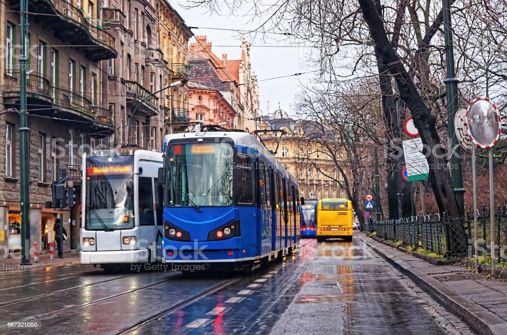 Running trams in city center of Krakow stock photo
