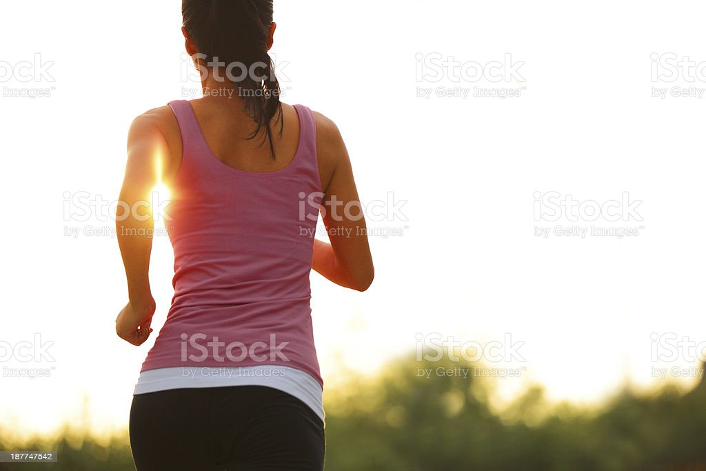 running under sunrise stock photo