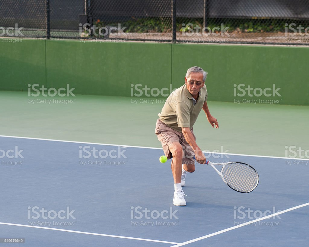 Running up for the low ball stock photo