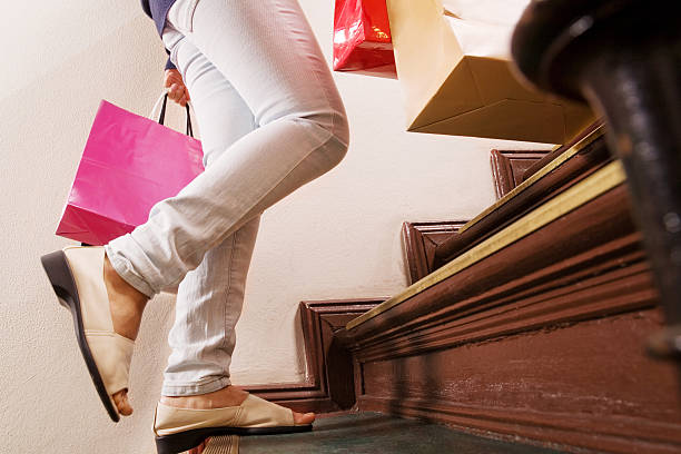 running up the stairs after shopping - flat shoe stock pictures, royalty-free photos & images