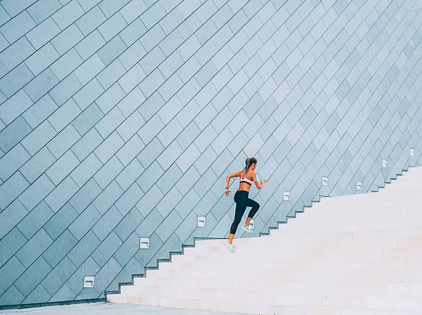 running up the stairs - endurance stock pictures, royalty-free photos & images