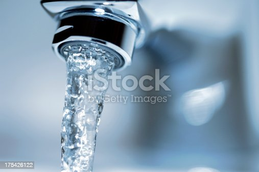 Faucet close-up with running water.