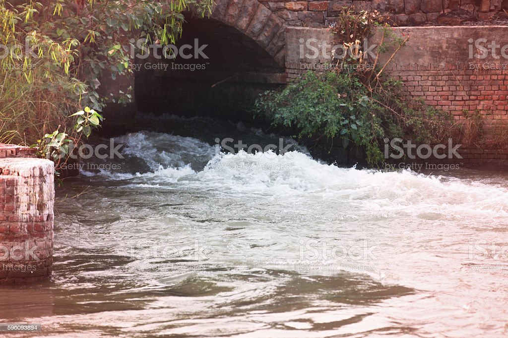 Running water rapidly from water dam royalty-free stock photo