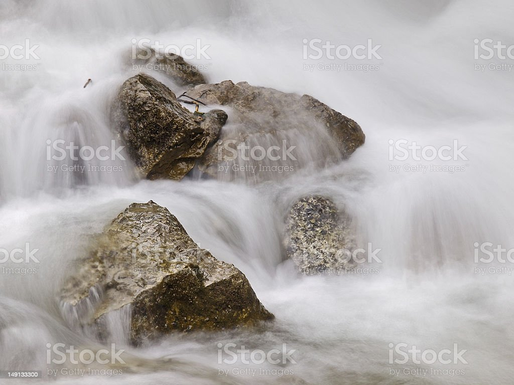 Running water with rocks royalty-free stock photo
