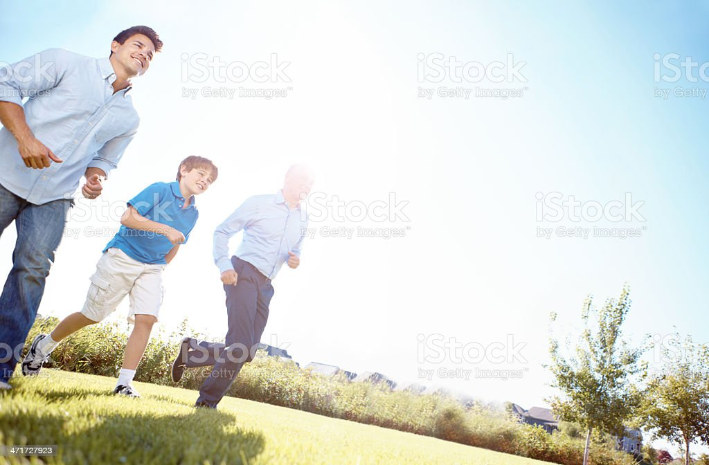 Running with dad and grandpa royalty-free stock photo