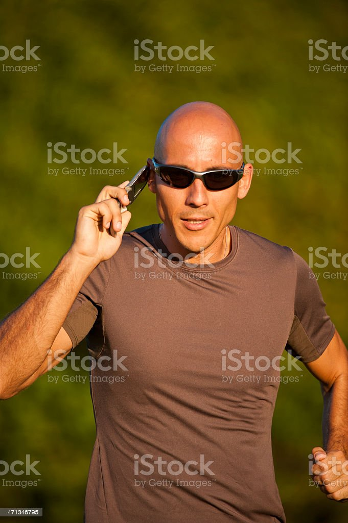Running with the phone royalty-free stock photo