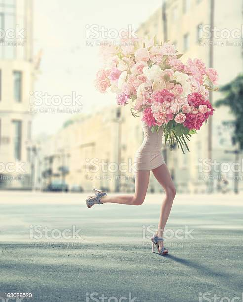 Photo of running women with giant bunch of flowers