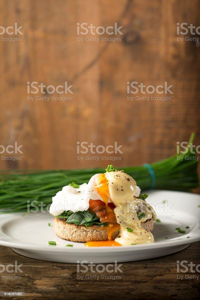 Runny Egg Yolk on Smoked Salmon Muffin stock photo