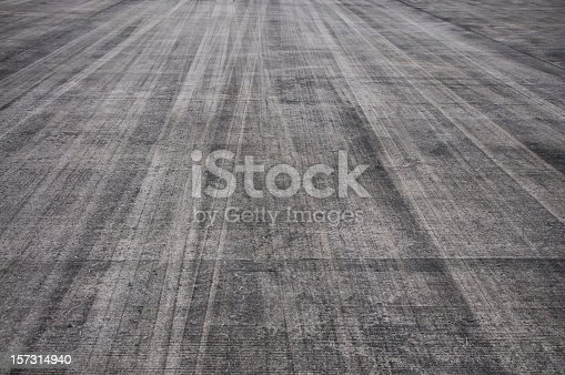Rubber tyre markings on a tarmac runway.
