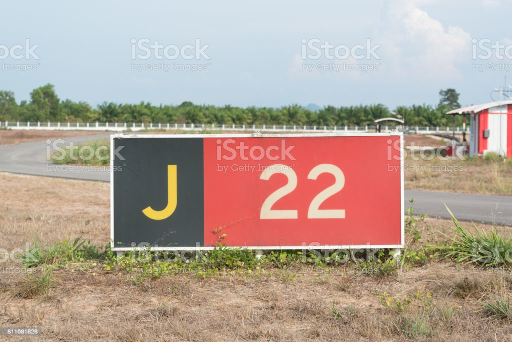 Runway holding postion sign with taxtiway locaion sign stock photo